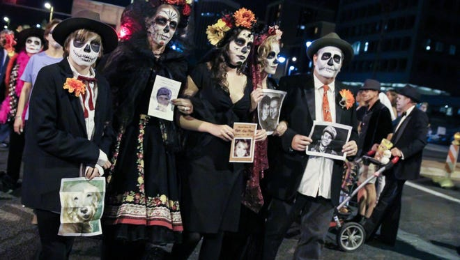 The All Souls Procession in Tucson is a celebration and mourning of the lives of loved ones who have passed.
