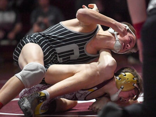 Centennial's Eric Owens tries to flip Ankeny's Spencer Anderson during a wrestling match between the Ankeny Hawks and the Centennial Jaguars on Thursday, Jan. 18, 2018 at Ankeny High School.