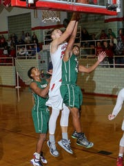 St. Joseph's Auras Tverijonas has a layup in an 80-74 win over Cedar Creek on Jan. 15.