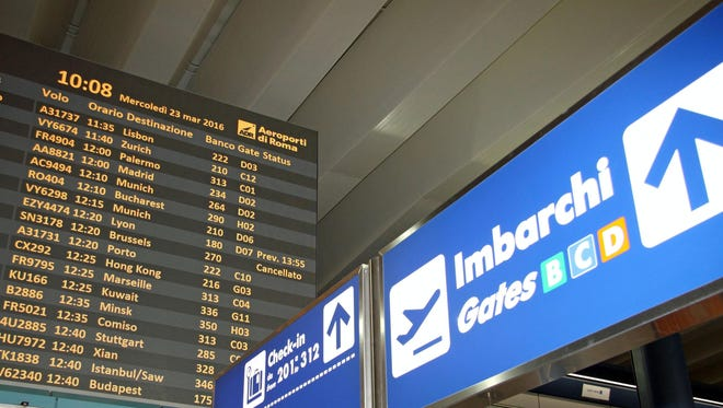 A departure board at Rome's major international airport shows a canelled flight to Brussels on March 23 2016.