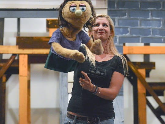 Melissa Cotton Hunter and her puppet cast mate Kate