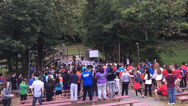 Students celebrate an outdoor Mass at Camp Saginaw at New London, Penn.