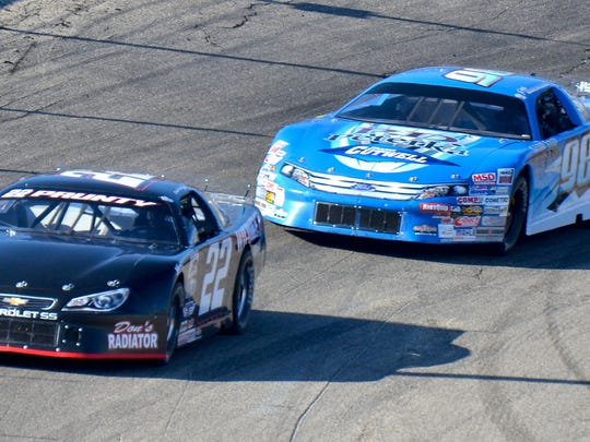 Dennis Prunty leads Rob runner-up Rob Braun at Slinger Speedway on Sunday, April 26, 2015.