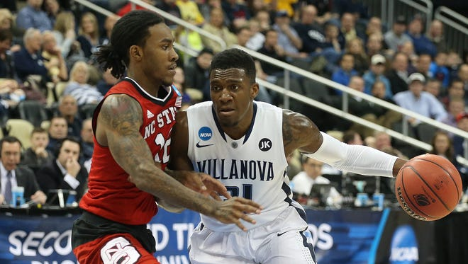 Mar 21, 2015; Pittsburgh, PA, USA; Villanova Wildcats guard Dylan Ennis (31) dribbles the ball as North Carolina State Wolfpack guard Anthony Barber (12) defends during the first half in the third round of the 2015 NCAA Tournament at Consol Energy Center. Mandatory Credit: Charles LeClaire-USA TODAY Sports