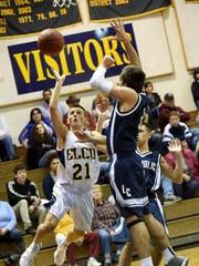 Raider Evan Huey pushes inside against the Lebanon Catholic defense Thursday night at Elco High School. Elco defeated LC 86-44.