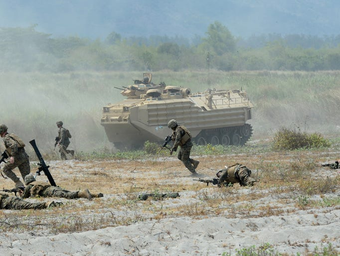 U.S. Marines take positions with mortars and an amphibious