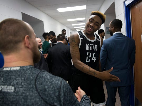 USC Upstate's Malik Moore (24) celebrates with the rest of his team after narrowly defeating FGCU 62-60 at Alico Arena Thursday, Jan. 19, 2017 in Estero.