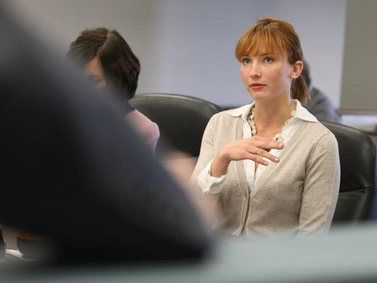 Zoe Everett speaks during her lawsuit settlement.