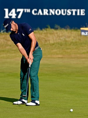 Justin Thomas putts on the 18th green during the first round of The Open Championship golf tournament at Carnoustie Golf Links in Carnoustie, Scotland, on July 19, 2018.