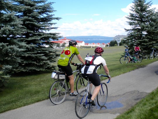 "Michigander veterans Ron Lenders, 57, of Shelby Township, left, and Brian Rumohr, 37, of Grosse Pointe pedal past Bay Harbor on the Little Traverse Wheelway -- one of Michigan's premier ""bicycle freeways"" -- just south of Petoskey during the 2010 Michigander."