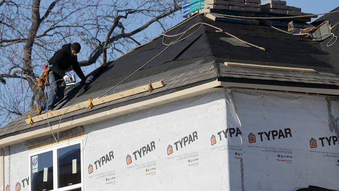 A construction worker builds a new home in Wilmette, Ill.