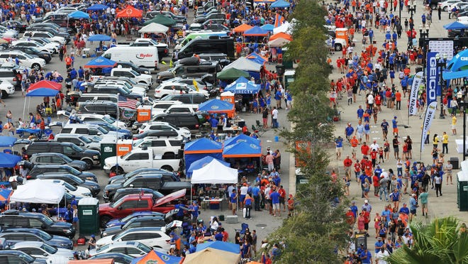 Fans tailgate outside TIAA Bank Field before the start of the 2017 Florida-Georgia football game. No tailgating will be allowed in stadium or city-owned parking lots for the 2020 game.