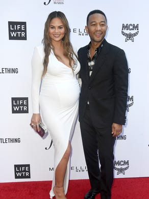 The same month, Chrissy and John hit the red carpet
