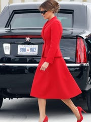 First lady Melania Trump, clad in a red Dior suit,