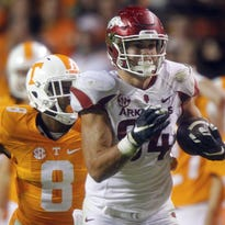 In this Oct. 3, 2015 file photo, Arkansas tight end Hunter Henry (84) outruns Tennessee defensive back Justin Martin (8) during the second half in Knoxville, Tenn.