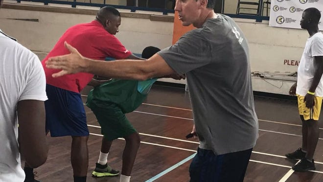Plank coaching during a basketball camp on the island