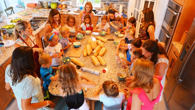 A group of moms joined forces to host a three day-cooking camp for their 13 children, ages 3 to 9. The camp culminated in a Daddy Dinner with the children serving their fathers a dinner of salad, lasagna, garlic bread and tiramisu.