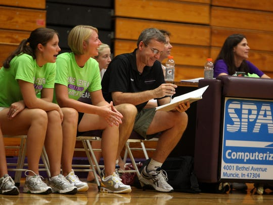 New Central volleyball coach Kate Hughes, left, during