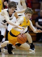 Barr-Reeve's Isaac Wagler (12) fights for a loose ball with Morristown's Eli Streevalin the second half of their IHSAA boys semi-state basketball game in Seymour on March 16, 2018. Morristown defeated Barr-Reeve, 77-70.