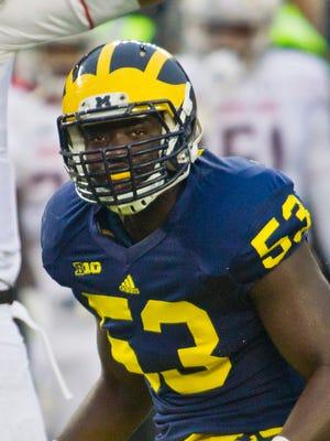 Michigan defensive end Mario Ojemudia plays Nov. 22, 2014.