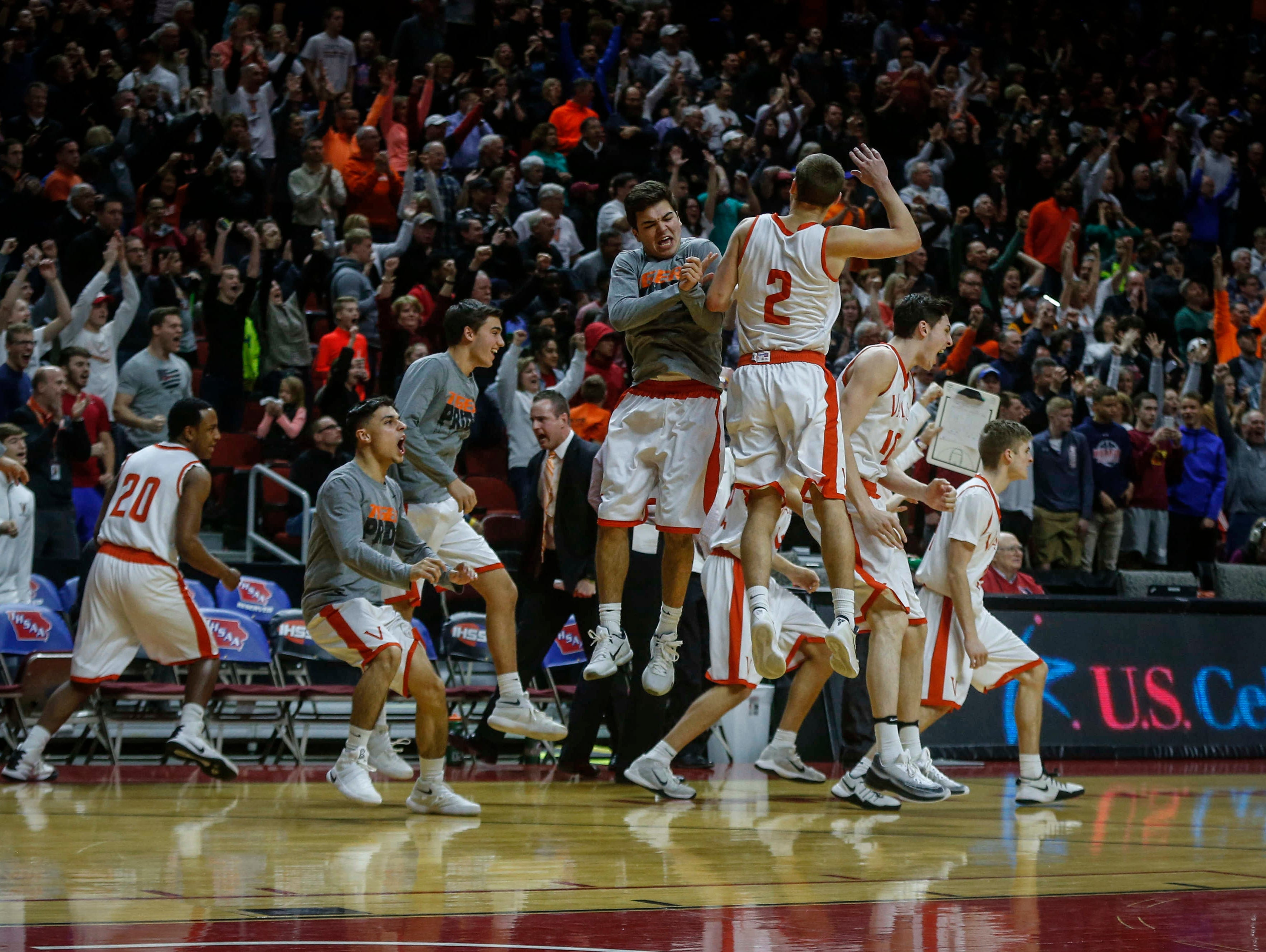 Members of the West Des Moines Valley basketball team celebrate after a win over Des Moines North during the Iowa High School state basketball tournament at Wells Fargo Arena in Des Moines on Wednesday, March 8, 2017.