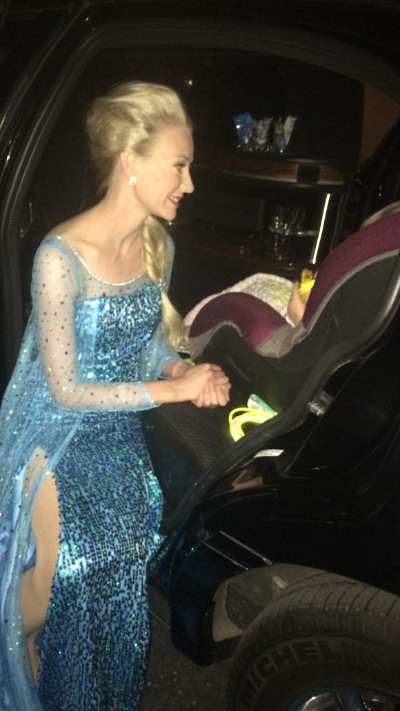 Jamie Scott, dressed as a princess, talks to little