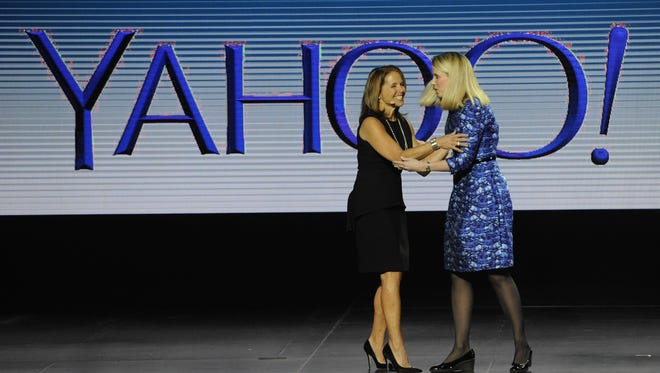 Marissa Mayer of Yahoo greets Katie Couric at the Consumer Electronics Show in Las Vegas.