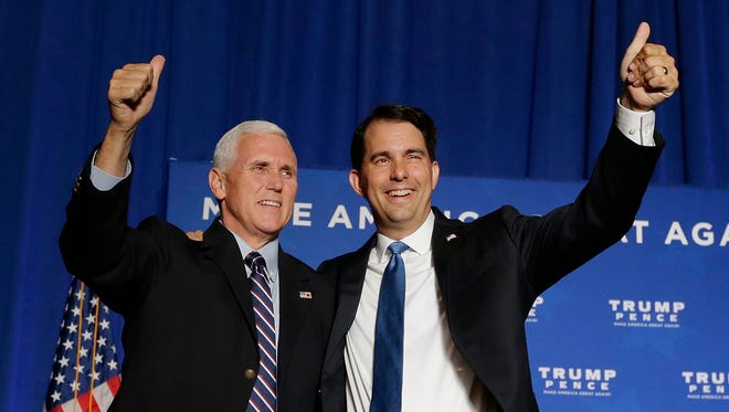 Wisconsin Gov. Scott Walker joins Vice President-elect Mike Pence at a rally on Aug. 11 in downtown Milwaukee.