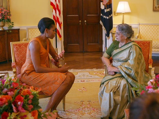 First Lady Michelle Obama meets with  Gursharan Kaur, wife of the prime minister of India, in the Yellow Oval Room of the White House, in November 2009, after room was redone for the Obamas by designer Michael Smith.