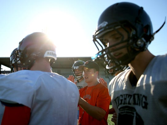 Silverton football head coach Josh Craig, 26, leads