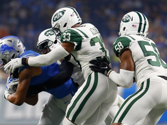 Jets inside linebacker Darron Lee (58) helps bring