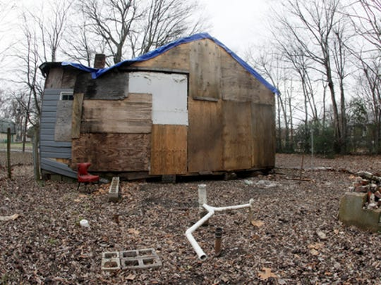 In this Jan. 16, 2017 photo, the abandoned childhood home of singer Aretha Franklin sits behind a security fence in Memphis, Tenn. Officials in charge of fixing up the home say they are working with the DIY Network to move the crumbling structure to a safer location and make it more attractive for visitors. The boarded-up house sits in a blighted neighborhood filled with abandoned homes. A judge had ordered it demolished, but he put that order on hold after preservationists stabilized the house.