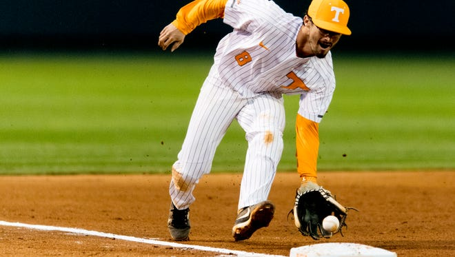 Tennessee infielder Brandon Chinea (8) catches a ground ball during a game between Tennessee and Alabama at Lindsey-Nelson Stadium in Knoxville, Tennessee on Friday, March 23, 2018.