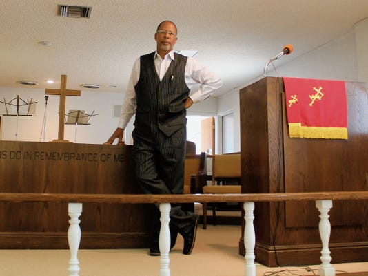 Otero County's African Methodist Episcopal Owen Chapel Rev. Warren Robinson stands on the alter of his church Thursday. Robinson talked about AME Church being inclusive to all people and dealing with grief through scriptures.