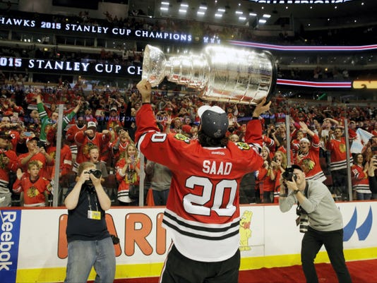 Chicago Blackhawks' Brandon Saad celebrates after defeating the Tampa Bay Lightning in Game 6 of the Stanley Cup Final series on Monday in Chicago. The Blackhawks defeated the Lightning, 2-0, to win the series 4-2.