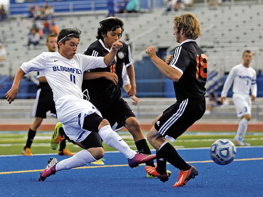 Bloomfield's Miguel Pereyra scores the first goal against Aztec Thursday at Bobcat Stadium in Bloomfield.