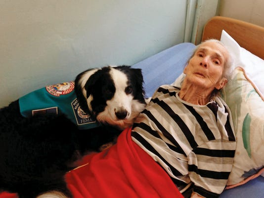 Ace shares his love, comfort and joy with the now deceased Florence Howerton, who resided in the nursing home at Lakeview Christian.