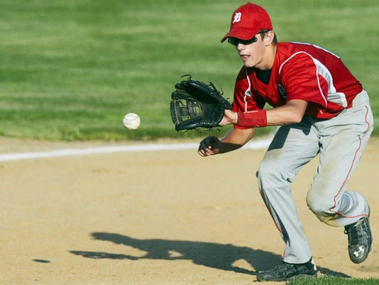 Dover's Trent Raber fields a ground ball during a Central League baseball game in Dover on July 16. Dover beat Manchester, 9-2.