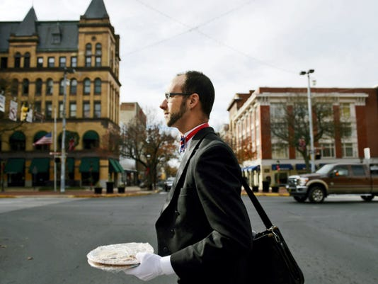 Dressed in his butler's outfit, complete with a United Kingdom-themed bowtie, Jason Holland carries his computer and two plates of freshly baked cookies to a client meeting in downtown York in November. While Travel Simplicity is a one-man operation, Jason is looking to hire a part-time employee. He and Sandy realized this year they need more help to grow the business.