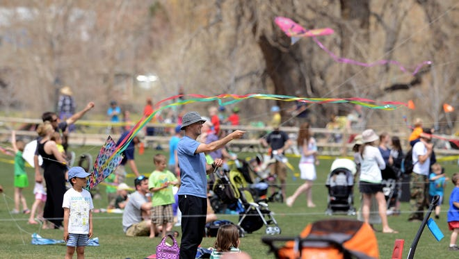People fill up the grass and the sky above it on Sunday, April 28, 2013, as they enjoy that year's Kites in the Park at Spring Canyon Community Park in Fort Collins.