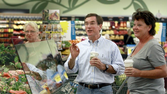 David Dillon (center) speaks with customer Pat O'Keefe, right, inside a Kroger store in Montgomery in 2010. Dillon is stepping down as Kroger's chairman.