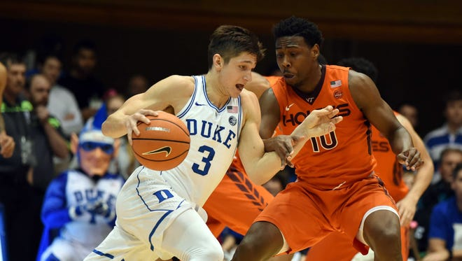 Duke Blue Devils guard Grayson Allen(3) drives to the basket as Virginia Tech Hokies guard Justin Bibbs (10) defends during the first half at Cameron Indoor Stadium.