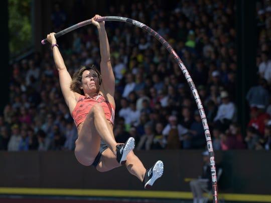 Jenn Suhr of Riga wins the women's pole vault  at 15-11