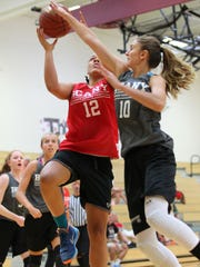 Southern Tier's Alani Gallagher gets fouled on the way to the basket by Nora Gabel from Suffolk in the BCANY Summer Hoops Festival.