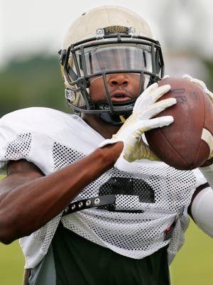 Cornerback Myles Norwood catches the ball as Purdue football practices Thursday, August 11, 2016, on the campus of DePauw University in Greencastle.