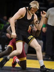 Iowa's Phillip Laux wrestles with Iowa State's Earl Hall at 133 pounds on Saturday, December 10, 2016 at Carver Hawkeye Arena. Hall won 5-3.