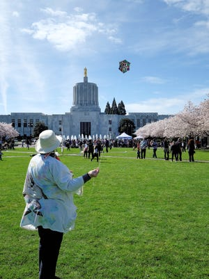 Fly a kite during Cherry Blossom Day at the Oregon State Capitol March 18.