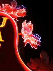 Jack's Bar-B-Que's sign was inspired by the fairy tale about three little pigs.