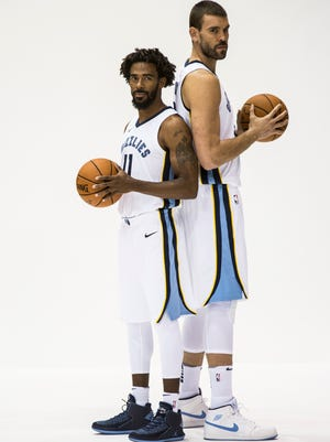 September 25, 2017 - Mike Conley, left, and Marc Gasol pose for a picture together during the Grizzlies' media day at the FedExForum.