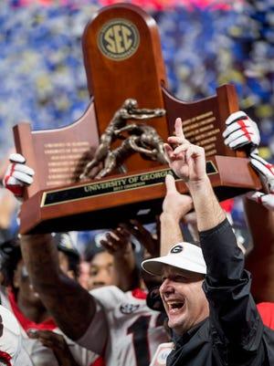 Georgia head coach Kirby Smart clebrates winning the SEC Championship Game at Mercedes-Benz Stadium in Atlanta, Ga. on Saturday December 2, 2017. (Mickey Welsh / Montgomery Advertiser)
